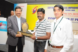 Mr. M. Raghuraman and Mr. R. Srinivasan from Ramco Systems collecting the award from Mr. Arun Jain, Polaris Software